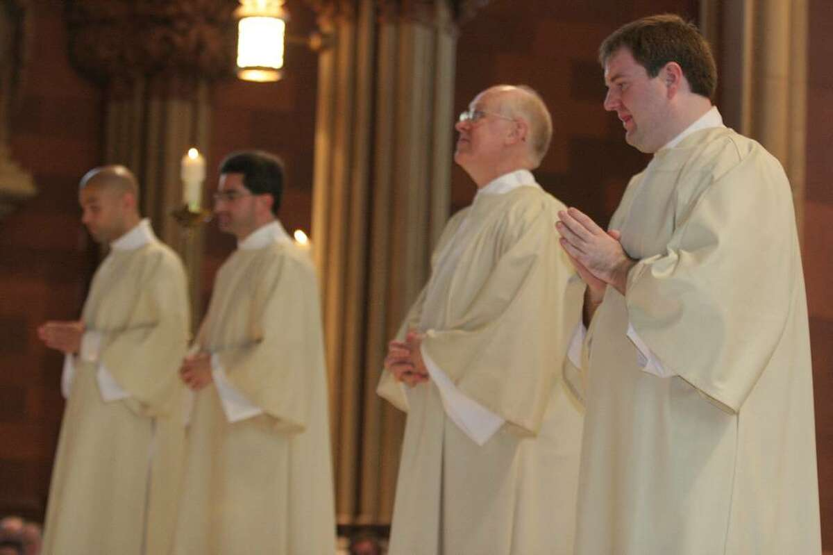 From left, J. Michael Taylor, Paul Kisselback, Walter Ayres and Jay Atherton are ordained deacons during a ceremony Saturday in Albany. Taylor and Atherton will continue their studies for the priesthood. (Submitted photo by Nate Whitchurch)