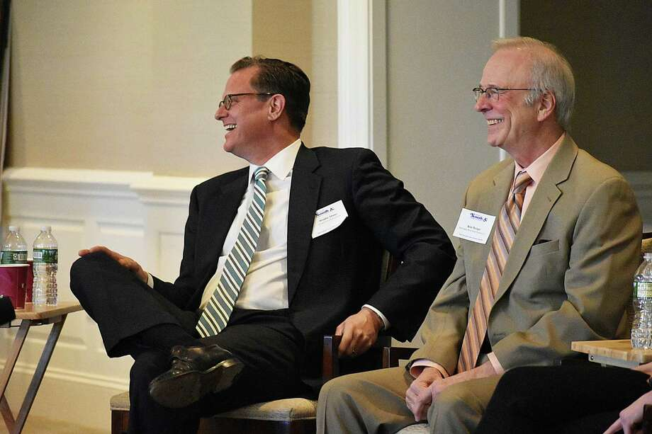 Doug Adams (left), senior director of development and municipal analysis for SoNo Collection mall developer GGP, alongside Spinnaker Real Estate Partners principal Kim Morque during a real estate panel discussion. The event was held April 5, 2018, at Shorehaven Country Club in Norwalk, Conn., and sponsored by the Greater Norwalk Chamber of Commerce and the Westport Weston Chamber of Commerce. Photo: Alexander Soule / Hearst Connecticut Media / Stamford Advocate