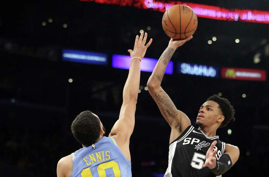 """Dejounte Murray, shooting over the Lakers' Tyler Ennis (10), says the Spurs' veterans """"are not going to lie and say they are not tired."""" Photo: Reed Saxon /Associated Press / Copyright 2018 The Associated Press. All rights reserved. This material may not be published, broadcast, rewritten or redistribu"""