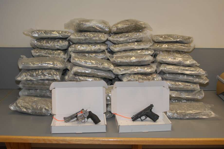 Albany police seized more than 100 pounds of marijuana, two handguns and more than $60,000 in cash in a months-long investigation sparked by shots fired in February 2018. Photo: Albany Police