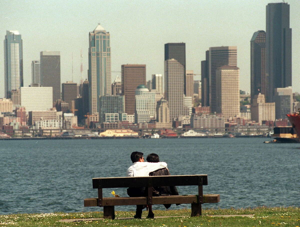 (L)Khiet Ta and Anh Phan enjoy the view of downtown from Alki more than 20 years ago, on a typical sunny (but not smoky) day.