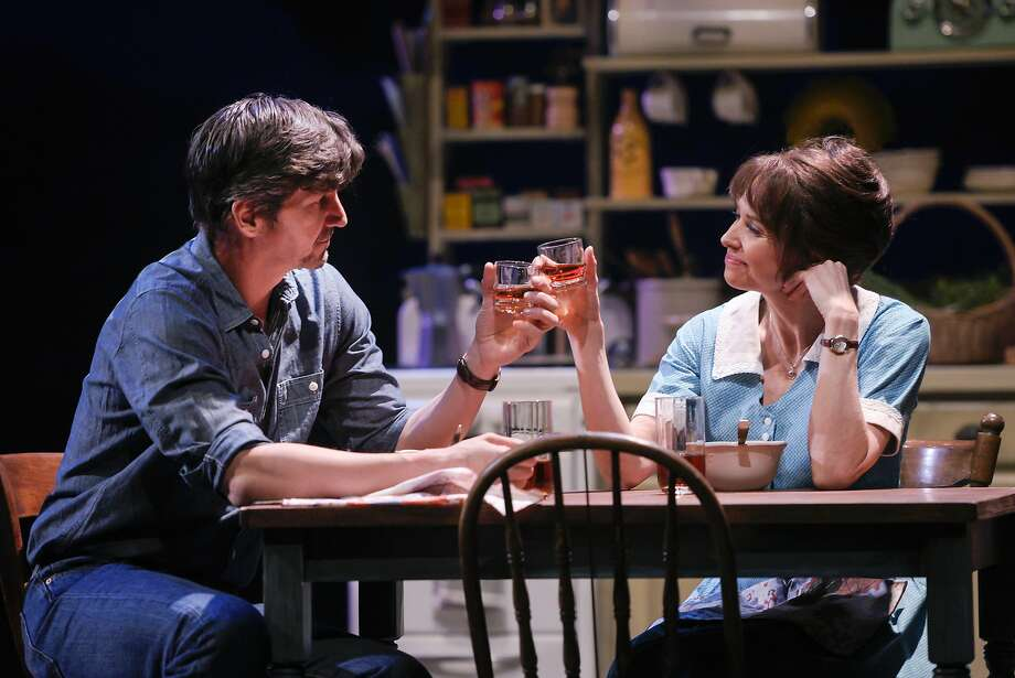 "Robert (Rob Richardson) and Francesca (Joan Hess) share a special bottle of brandy in TheatreWorks' ""The Bridges of Madison County,"" adapted from the wildly popular book about an affair between a lonely Iowa homemaker and a roving photographer. Photo: Kevin Berne / TheatreWorks"