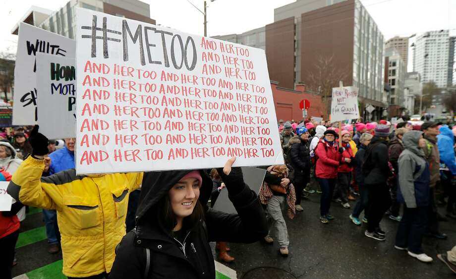 In this Saturday, Jan. 20, 2018 file photo, a marcher carries a sign with the popular Twitter hashtag #MeToo used by people speaking out against sexual harassment as she takes part in a Women's March in Seattle, on the anniversary of President Donald Trump's inauguration. Photo: Ted S. Warren, Associated Press