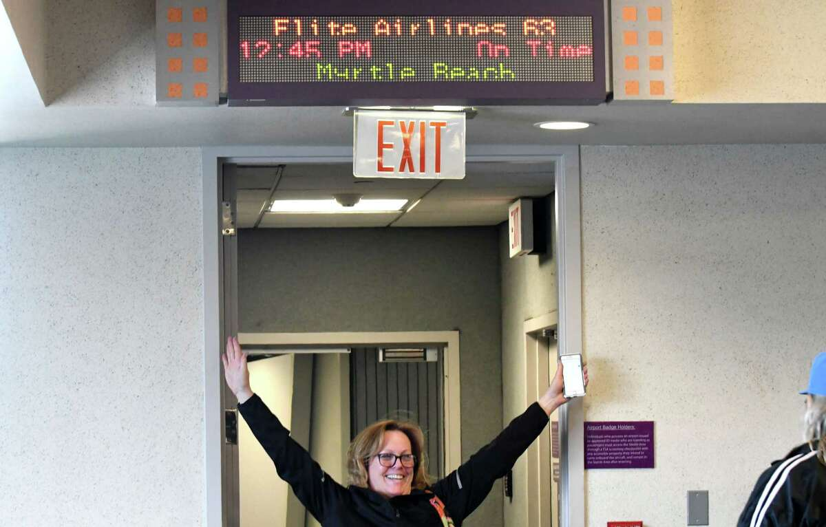 Passengers celebrate being the first to take Elite Airways' non-stop flight to Myrtle Beach from Albany International Airport on Thursday, April 5, 2018, in Colonie, N.Y. The airline offers twice-weekly flights on Thursday and Sunday. (Will Waldron/Times Union)