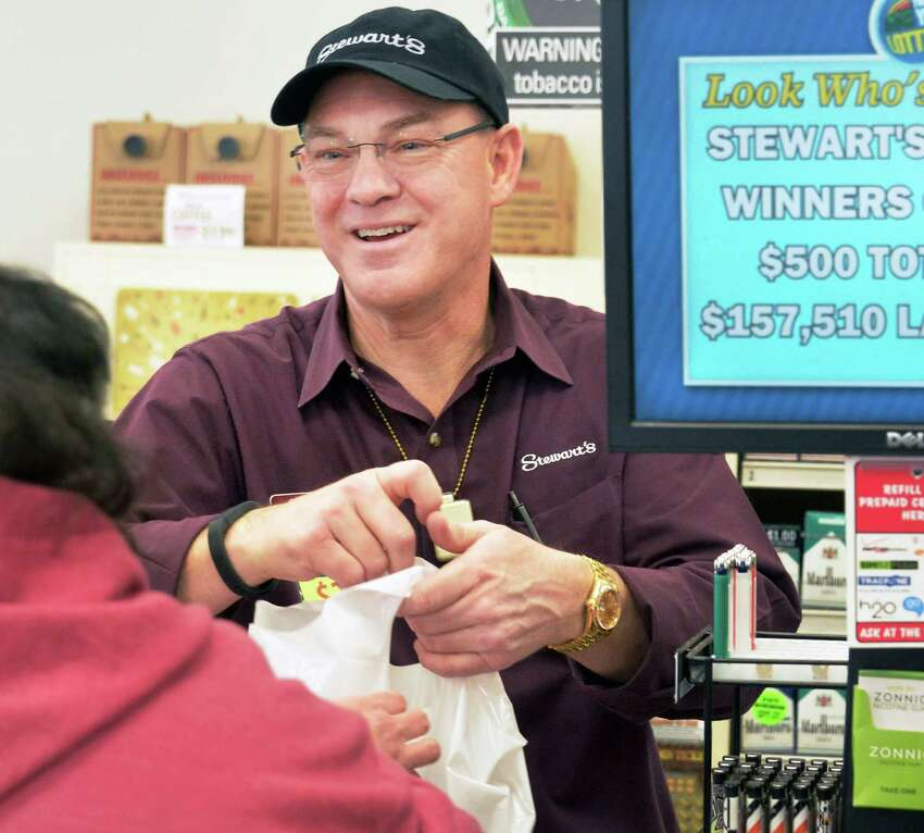 Stewart's President Gary Dake works the register in their Mariaville Rd. shop Thursday Feb. 18, 2016 in Rotterdam, NY. Dake worked in the store to thank customers there who donated $8,500 to an end of year fundraiser for charity. (John Carl D'Annibale / Times Union)