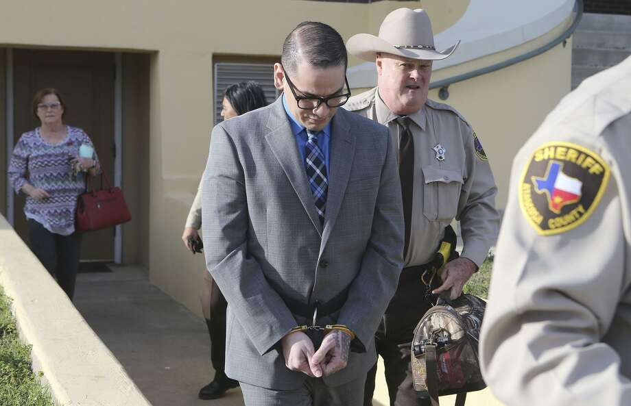 Murder defeandant Shaun Puente (center, cuffed) leaves court in Jourdanton, Texas Thursday March 8, 2018. Shaun Puente is accused in the 2013 murder of San Antonio police officer Robert Deckard. Puente is accused of shooting Deckard,31, in the forehead as he led a chase from San Antonio into Atascosa County. Photo: John Davenport, STAFF / San Antonio Express-News / ©John Davenport/San Antonio Express-News