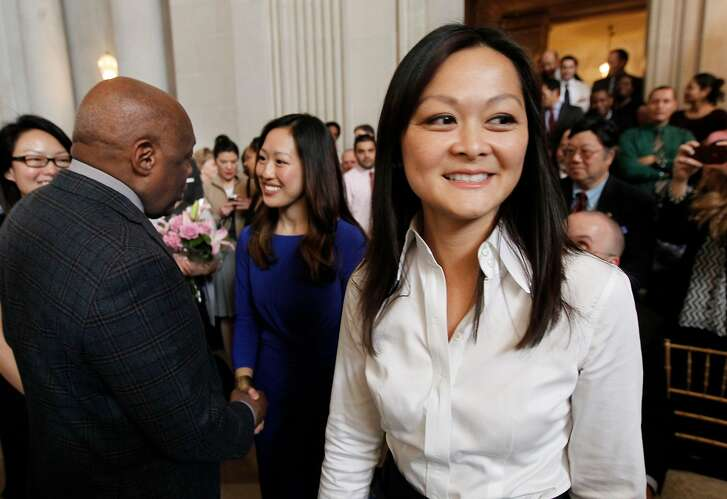 Former Mayor Willie Brown, (left) greets the soon to be new city officials as Mayor Ed Lee prepares to swear in Katy Tang, (center) as San Francisco Supervisor for District 4 and Carmen Chu, (right) as Assessor-Recorder at San Francisco City Hall on Wednesday Feb. 27, 2013.