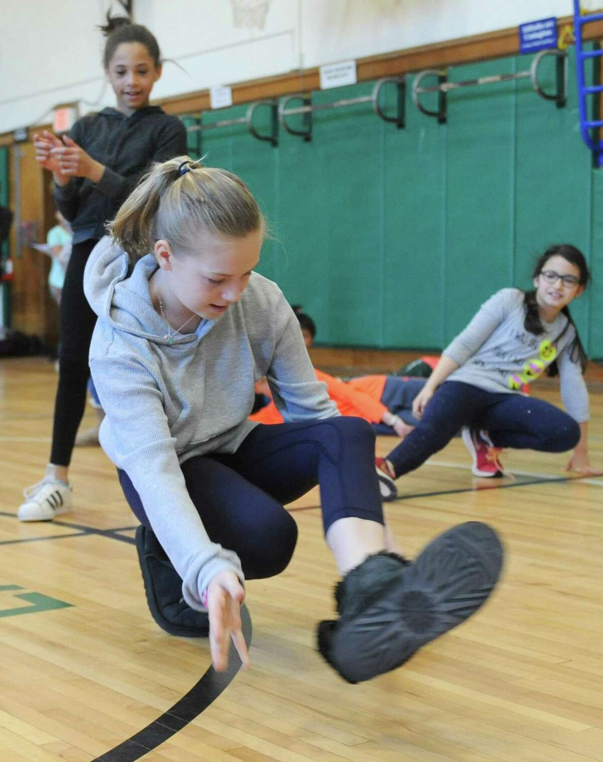 Fifth-grader Talia Muir breakdances during the Brazilian and Hip-Hop Dance Performance at Julian Curtiss School in Greenwich, Conn. Thursday, April 5, 2018. Connecticut Ballet teaching artists joined Julian Curtiss fourth- and fifth-graders for six weeks to teach dance during physical education classes. The lessons culminated with a performance in front of parents and then the entire school on Thursday. The lessons and performance were made possible with funding from the Greenwich Alliance for Education.