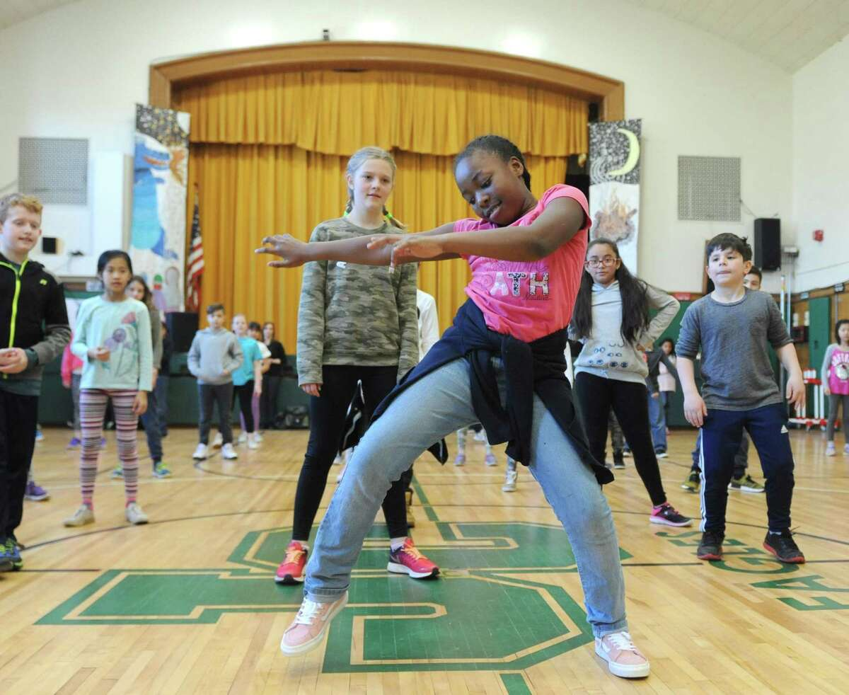 Fourth-grader Anniyah Brown dances to hip hop during the Brazilian and Hip-Hop Dance Performance at Julian Curtiss School in Greenwich, Conn. Thursday, April 5, 2018. Connecticut Ballet teaching artists joined Julian Curtiss fourth- and fifth-graders for six weeks to teach dance during physical education classes. The lessons culminated with a performance in front of parents and then the entire school on Thursday. The lessons and performance were made possible with funding from the Greenwich Alliance for Education.