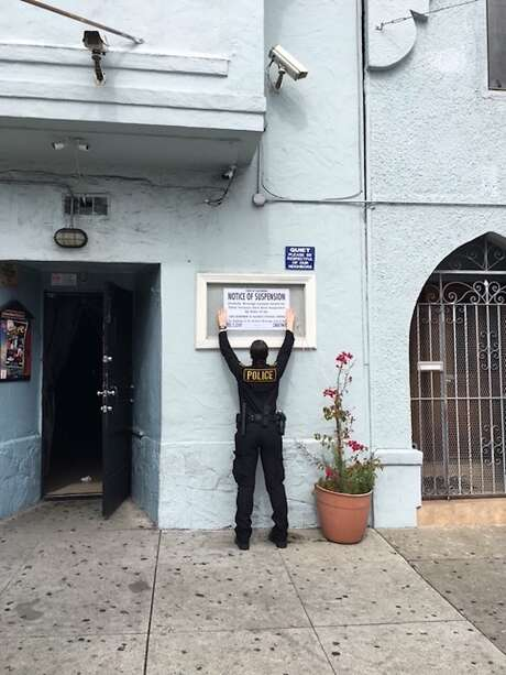 An agent with the California Department of Alcoholic Beverage Control placed a notice of suspension Thursday at La Oficina in San Francisco. Photo: California Department Of Alcoholic Beverage Control