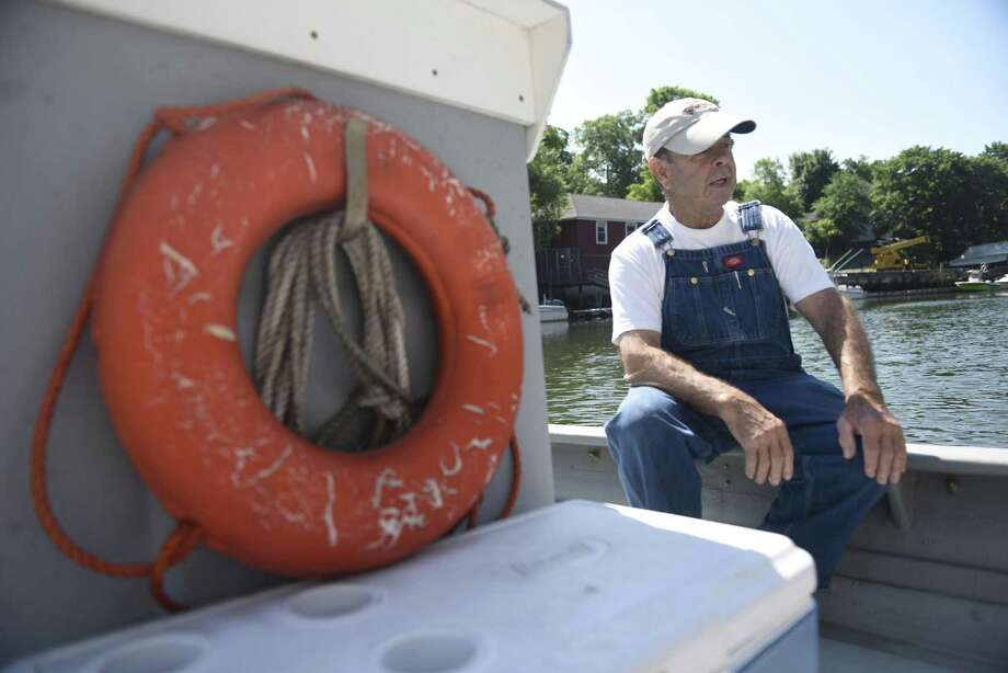 Ed Stilwagen sits on his boat docked in Port Chester, N.Y. before heading out to his clamming boats in the waters of the Long Island Sound off the coast of Greenwich, Conn. on Wednesday, June 22, 2016. Stilwagen is the owner of Atlantic Clam Farms, based in Port Chester, N.Y., with clamming property located in the waters of the Long Island Sound off the coast of Greenwich. Photo: Tyler Sizemore / Hearst Connecticut Media / Greenwich Time