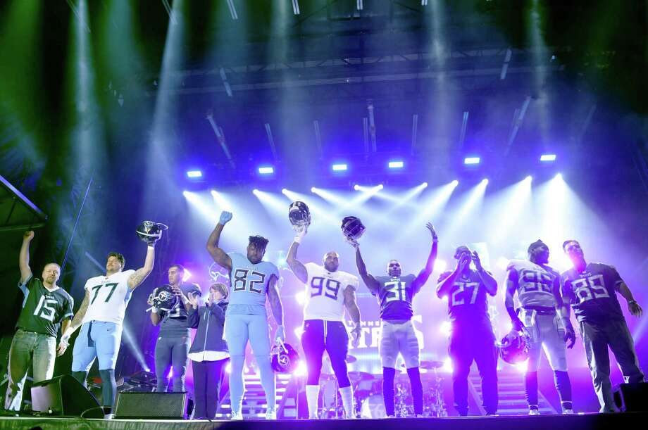 "NASHVILLE, TN - APRIL 04:  Owner of the Tennessee Titans, Amy Adams Strunk, and a few of the Tennessee Titan players reveal their new jerseys during team up for the ""Tradition Evolved"" concert event in downtown Nashville to celebrate The Titans new 2018 uniforms on April 4, 2018 in Nashville, Tennessee. Photo: John Shearer, Getty Images For Florida Georgia / 2018 Getty Images"
