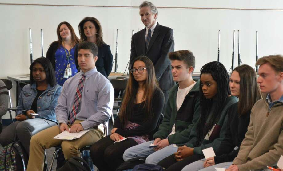 Superintendent of Schools Hamden High School Principal Nadine Gannon (standing) listen with students to U.S. Rep. Rosa DeLauro, D-3, discussing gun violence prevention April 5, 2018 Photo: Clare Dignan / Hearst Connecticut Media