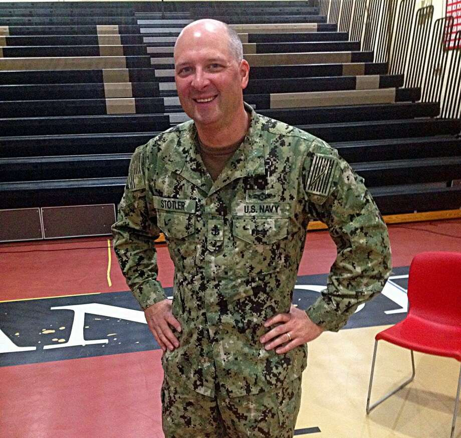 Twenty-year social studies teacher Chief Navy Petty Officer James Stotler, is also the varsity boys' soccer coach. He was welcomed home at Portland High School this week. Photo: Jeff Mill / Hearst Connecticut Media