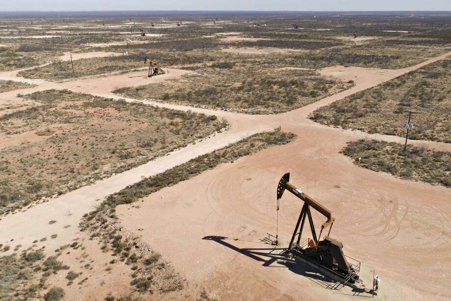 Pumpjacks operate on oil wells in the Permian Basin in this aerial photograph taken over Crane, Texas. Concho Resources Inc. (CXO) on Wednesday reported a second-quarter loss of $97 million, after reporting a profit in the same period a year earlier. Photo: Daniel Acker/Bloomberg
