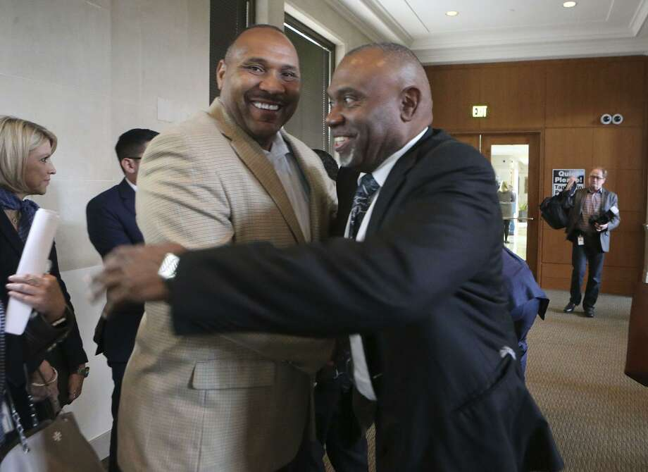 Outgoing board member Derrick Howard (left) and Willis Mackey embrace after Mackey was confirmed to the CPS Energy board Thursday. His confirmation by City Council was not unanimous, with three council members pointing out the lack of women on the board. Photo: John Davenport /San Antonio Express-News / ©John Davenport/San Antonio Express-News