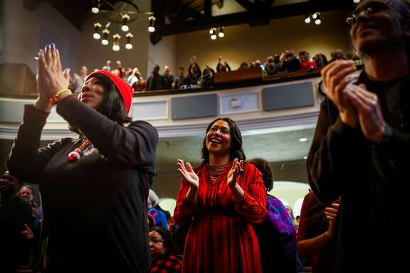 Acting Mayor London Breed (center) participates in Glide Memorial Church's Christmas Eve morning service in San Francisco, Calif., on Sunday, Dec. 24, 2017.