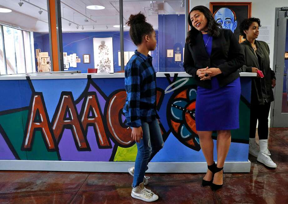 London Breed chats with Bianca Rachelle Bougere, 10, as she visits the African American Art & Culture Complex in San Francisco. Photo: Carlos Avila Gonzalez / The Chronicle
