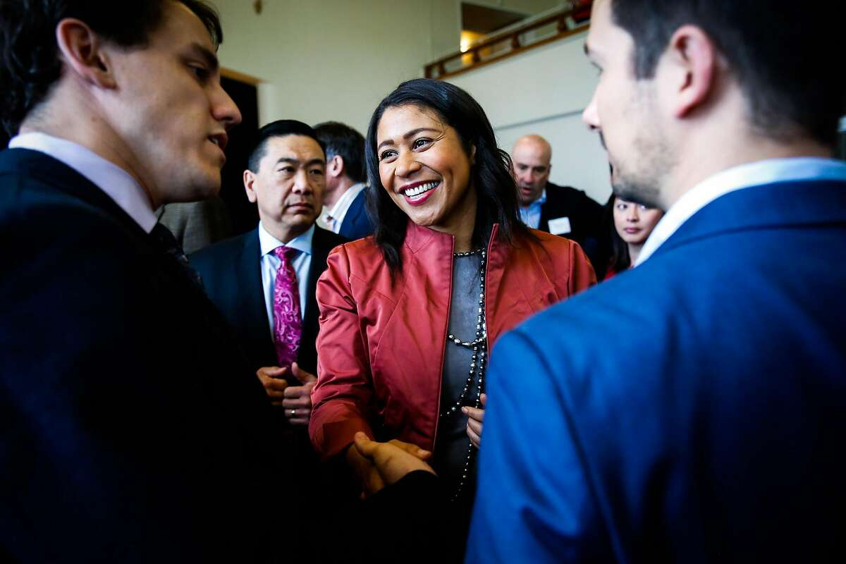 Acting Mayor London Breed (center) chats with guests at Congresswoman Nancy Pelosi's annual New Years celebration at the Golden Gate Club in San Francisco, California, on Sunday, Jan. 14, 2018.