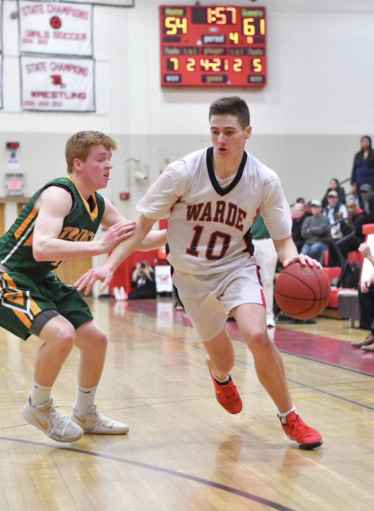 Fairfield Warde's Sean Conway, right, will play for the Connecticut team on Sunday in the JCC Classic at the Cardinal Shehan Center.