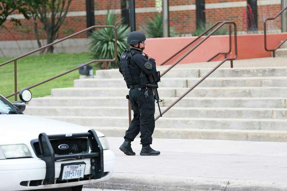 Armed law enforcement officials surround the building as Bexar County Sheriff Javier Salazar makes a statement about an attempted jail escape which occured in the morning on April 5, 2018. Photo: Tom Reel, San Antonio Express-News / 2017 415916Z.1 ANTONIO EXPRESS-NEWS