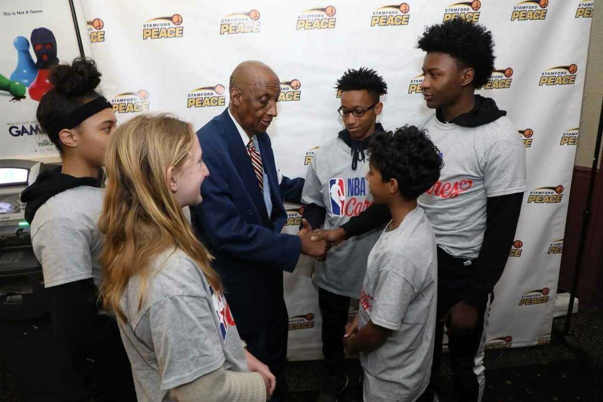 Former New York Knicks' star Dr. Dick Barnett speaks with students and athletes as part of Signature Bank's Scholars Program, which encourages young people to be college bound. In conjunction with Stamford Peace Youth Foundation and Beyond Limits Academic Program, all three organizations joined together to sponsor an event on Thursday at the State Theatre in Stamford, where Barnett addressed the students in a motivational manner about the importance of a college education.