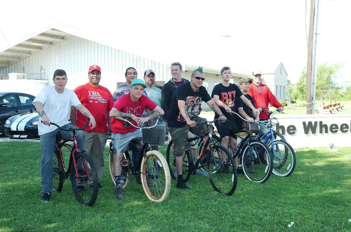 Residents of The Wheelhouse in Deer Park with bikes that were donated to replace ones that were stolen.