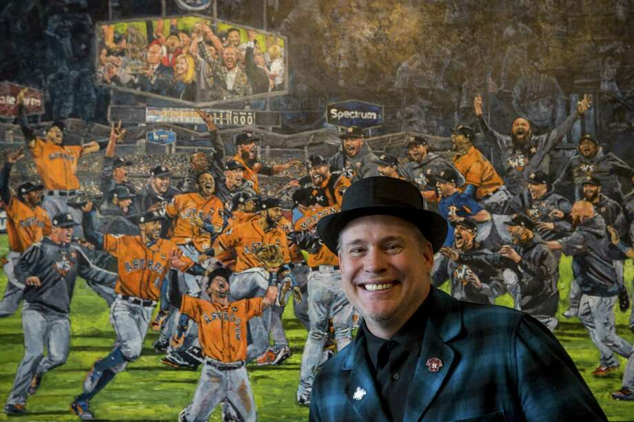 """Opie Otterstad poses for a portrait with his paintings at Off The Wall Gallery on Thursday, March 29, 2018, in Houston. Otterstad, a Houstonian who grew up with the Astros and has been an officially sanctioned artist for Major League Baseball for many years, made his largest """"celebration painting"""" yet to commemorate the 2017 World Series champions. Photo: Brett Coomer, Staff / Houston Chronicle / © 2018 Houston Chronicle"""