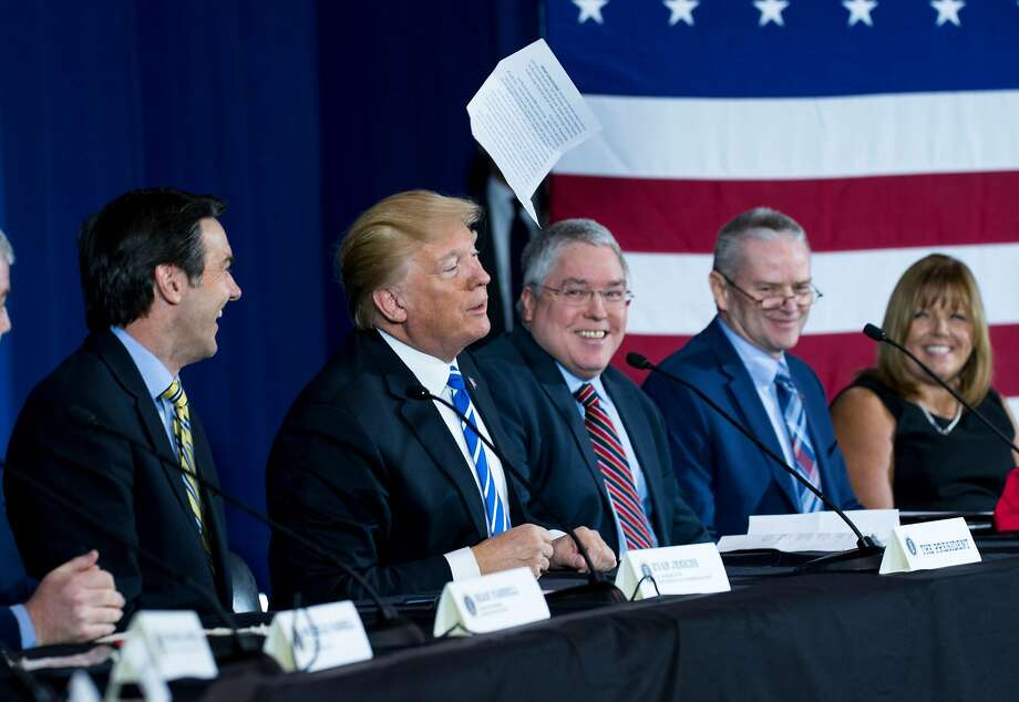 "EDS. RETRANSMISSION TO CORRECT BYLINE TO DOUG MILLS *** President Donald Trump tosses his ""prepared"" remarks into the air as he participates in a roundtable discussion on tax reform in White Sulphur Springs, West Virginia, April 5, 2018. (Doug Mills/The New York Times) Photo: DOUG MILLS, NYT"