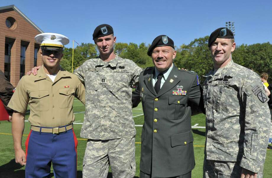 Marine 2nd Lt. Matt Blumenthal, left, with recipients of the 2010 Distinguished Alumni Award at Brunswick Upper School. Blumenthal has filed paperwork to run for the state House of Representatives 147th district. Photo: Contributed Photo / Contributed Photo / Greenwich Time Contributed
