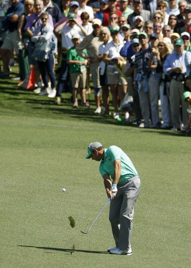 Sergio Garcia, of Spain, hits a ball in the water on the 15th hole during the first round at the Masters golf tournament Thursday, April 5, 2018, in Augusta, Ga. Garcia shot an 8-over 13 on the hole. (AP Photo/Charlie Riedel)