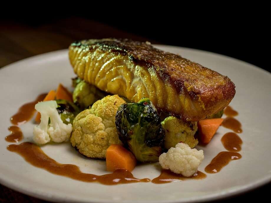 Crispy-skin salmon ($29) at Kaya. Photo: John Storey / Special To The Chronicle
