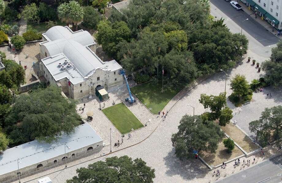 Alamo Plaza, with the Alamo at the top of the frame, is seen in a 2015 aerial photo.  A local Native American has filed a legal notice declaring it to be on an abandoned or unknown cemetery, a move that could delay the $450 million project to restore and enhance the sacred Texas shrine. Photo: WILLIAM LUTHER,  Staff / San Antonio Express-News / © 2015 San Antonio Express-News