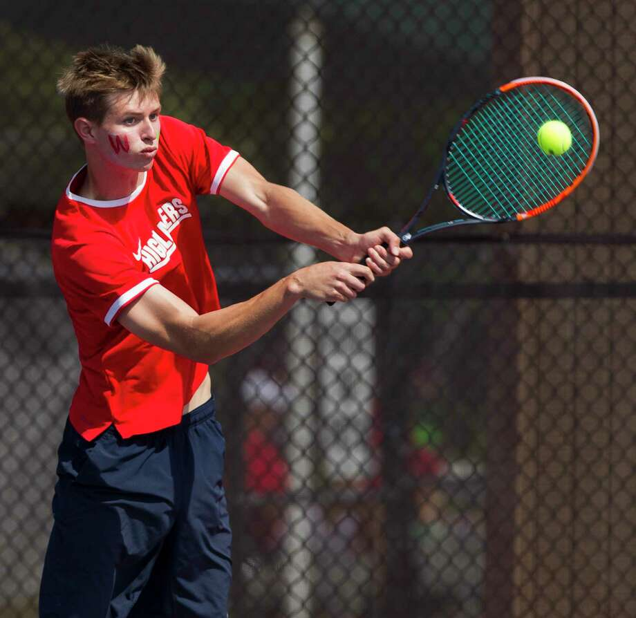 Hunter Bajoit of The Woodlands returns a serve during the District 12-6A tennis tournament at The Woodlands High School, Thursday, April 5, 2018, in The Woodlands. Photo: Jason Fochtman, Staff Photographer / © 2018 Houston Chronicle