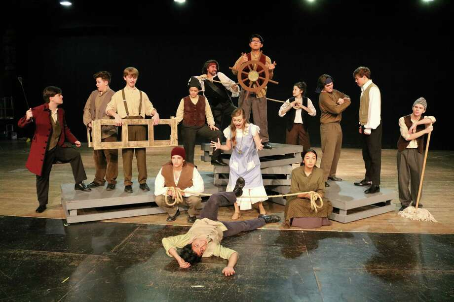 "In ""Peter and the Starcatcher,""Adrian Escareno, front, is thrown overboard, and Georgia Zaborowski prepares to save him. Beside Zaborowski are Jacob Hodges, left, and Hannah Orrego, and in back are Bailey Muschweck, Carson Couch, Sammy Zaborowski, Rachel Smith, Eric Land, Eric Navarro, Ashley Perez, Jeremy Hudspeth, Brett Rice and Luke Boriskie."