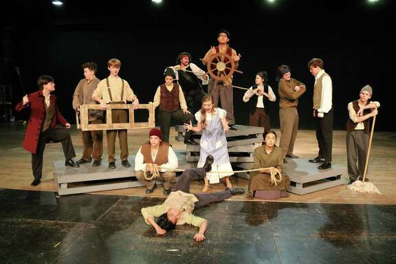 """In """"Peter and the Starcatcher,""""Adrian Escareno, front, is thrown overboard, and Georgia Zaborowski prepares to save him. Beside Zaborowski are Jacob Hodges, left, and Hannah Orrego, and in back are Bailey Muschweck, Carson Couch, Sammy Zaborowski, Rachel Smith, Eric Land, Eric Navarro, Ashley Perez, Jeremy Hudspeth, Brett Rice and Luke Boriskie."""