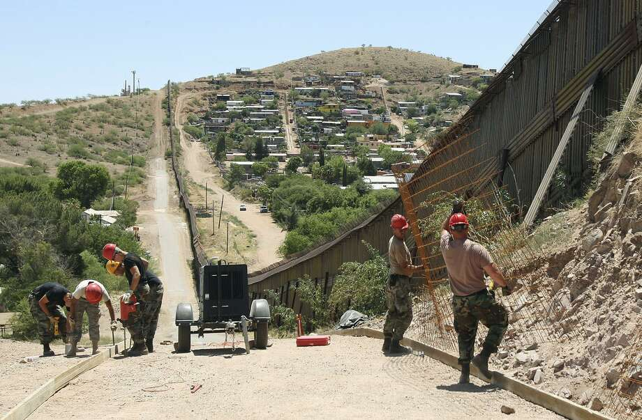 Members of the 200th Red Horse Air National Guard Civil Engineering Squadron build a road at the border in Nogales, Ariz., in 2008. When President Donald Trump said he wants the military to secure the border, he meant the National Guard. Photo: Ross D. Franklin /Associated Press / AP2008