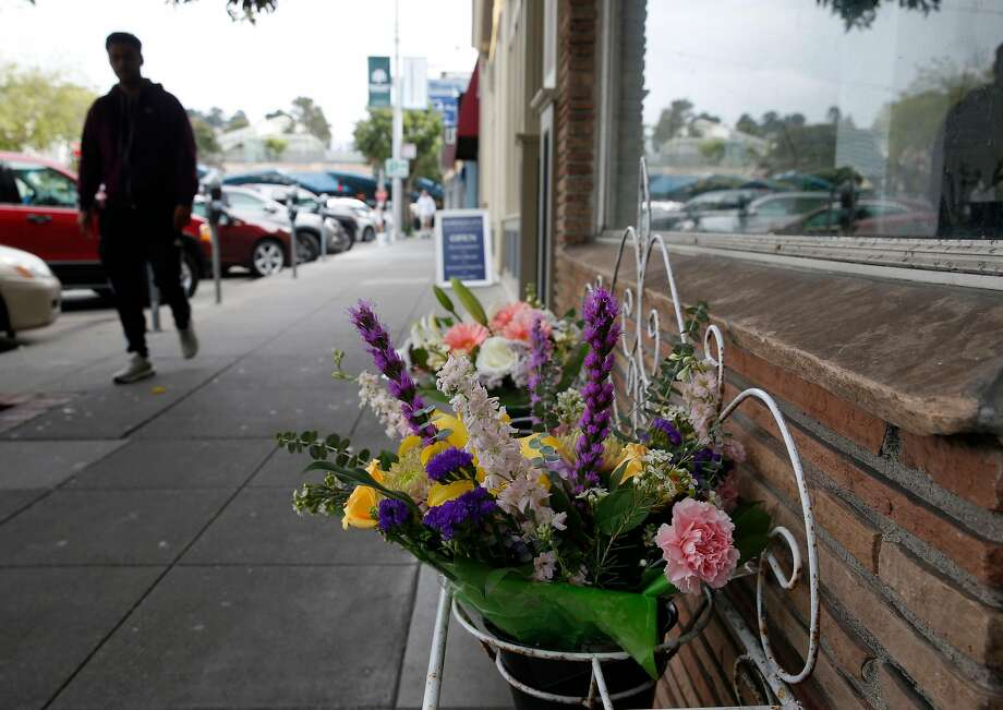 Flowers are displayed in front of the West Portal Floral Co. in San Francisco, Calif. on Thursday, April 5, 2018. Supervisor and mayoral candidate Jane Kim is opposing SB827, authored by state Sen. Scott Wiener, which would require cities to allow four- to eight-story apartment and condo buildings in residential areas if they are within a half mile of major transit hubs and would also mandate that cities allow such buildings within a quarter mile of highly used bus and light-rail stops. Photo: Paul Chinn / The Chronicle