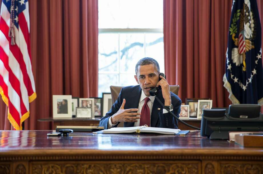 President Barack Obama talks on the phone with Nicole Hockley and families of the victims of the Sandy Hook Elementary School shootings in Newtown, Conn., in the Oval Office, April 11, 2013. (Official White House Photo by Pete Souza) Photo: Contributed Photo / Contributed Photo / Connecticut Post Contributed