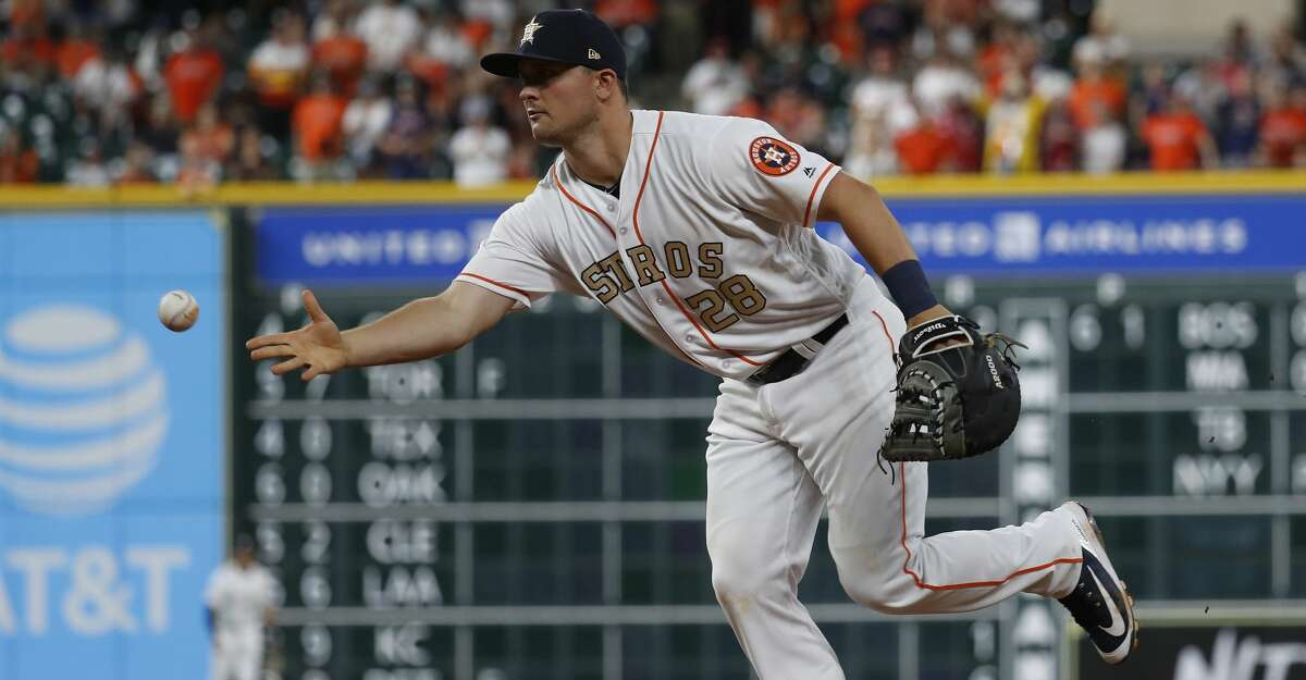 Houston Astros first baseman J.D. Davis (28) tosses the ball back to relief pitcher Collin McHugh as Baltimore Orioles Caleb Joseph ground out to end the home opener MLB baseball game at Minute Maid Park, Monday, April 2, 2018, in Houston. ( Karen Warren / Houston Chronicle )