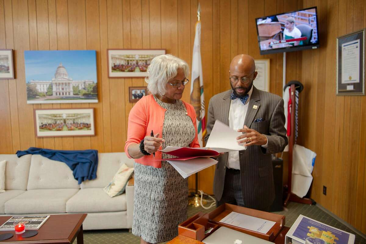 Assemblymember Mike Gipson, D-Carson, works in his office with scheduler Elaine E. Douglas at the state Capitol in Sacramento, Calif. on Wednesday, April 4, 2018. Gipson introduced a law that would enact a moratorium on arrests for minor offenses in foster-care facilities. He plans to introduce a $7.5 million budget proposal to better train facility staff and police, and fund diversion programs to keep foster youth out of the criminal justice system.