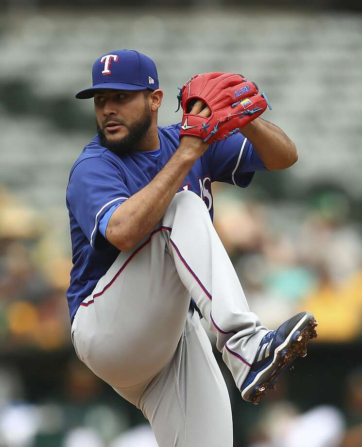Texas Rangers pitcher Martin Perez works against the Oakland Athletics during the first inning of a baseball game Thursday, April 5, 2018, in Oakland, Calif. (AP Photo/Ben Margot) Photo: Ben Margot / Associated Press