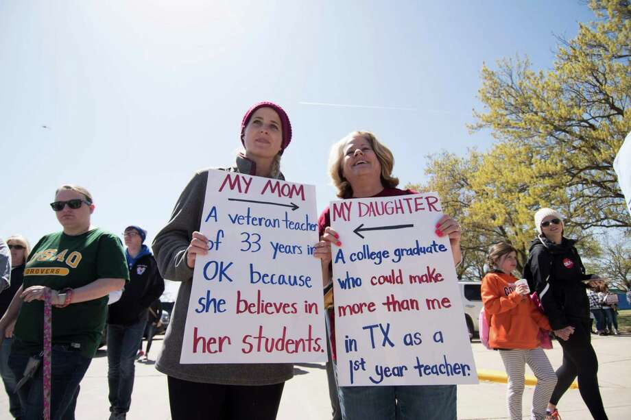 Rachell Cantrell and her school teacher mother Beth Cantrell march at the teachers rally at the state capitol in Oklahoma City on April 4, as Oklahoma becomes the latest state to be plagued by teacher strife. Students joined teachers in Oklahoma City Wednesday for a third day of protests demanding that state lawmakers increase funding for public schools after years of budget cuts. Oklahoma, where the oil and gas industry dominates, is among a handful of states that cut its education budget deeply as public coffers were drained by tax cuts and the 2008 economic downturn. Photo: J PAT CARTER,  Contributor / AFP/Getty Images / AFP or licensors