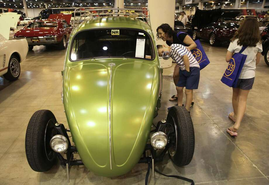 Samantha Gulino and her son, Luke, 7, check out a 1969 Volkswagen Beetle at the Mecum Auctions at NRG Center on Thursday, April 5, 2018, in Houston. The Gulino family came from Gonzales, Louisiana, to see the auction. More than 1,000 cars are featured in the three-day auction. Photo: Yi-Chin Lee / Houston Chronicle / © 2018 Houston Chronicle