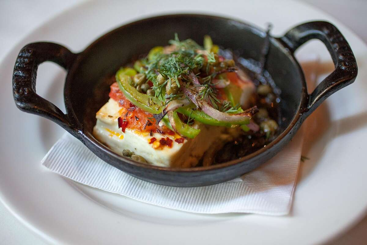 Feta sto Fourno, Greek feta baked with tomato, capers, and Metaxa brandy served at Kokkari in San Francisco Calif., Sunday March 29, 2015.
