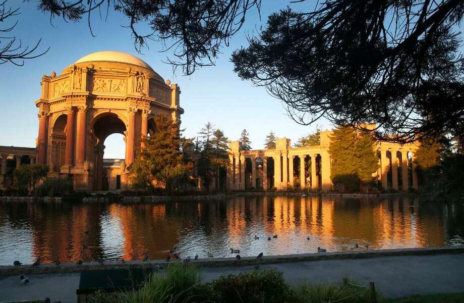 The Palace of Fine Arts is illuminated at sunrise in San Francisco, Calif. on Tuesday, Nov. 29, 2016. Photo: /