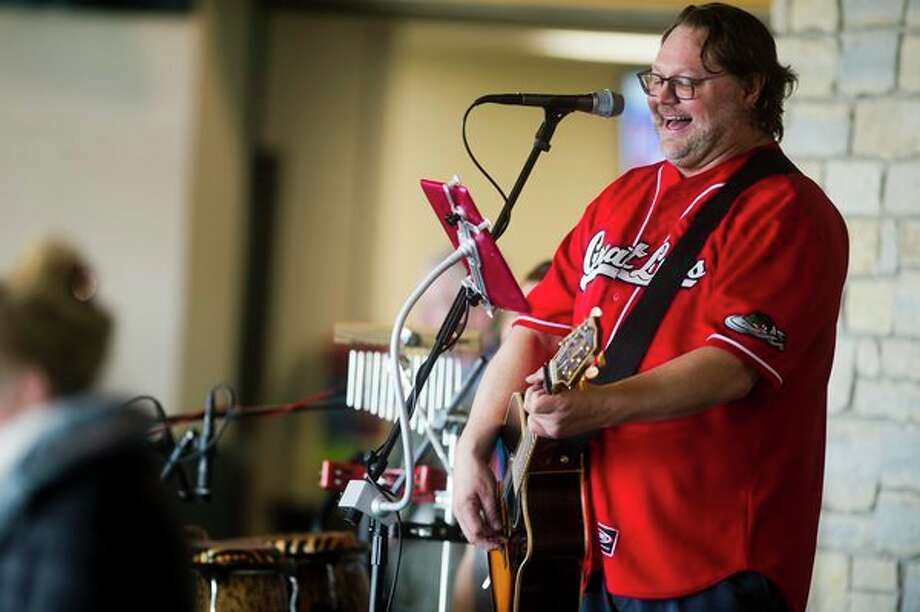 A band plays during 'Fan Fest' before the Great Lakes Loons' season-opening game against the Lansing Lugnuts on Thursday at Dow Diamond. (Katy Kildee/kkildee@mdn.net)