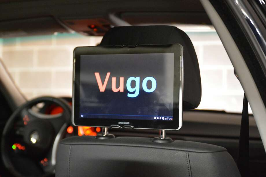 Futurists predict that screens in self-driving cars will provide passengers with ads. Photo: Vugo