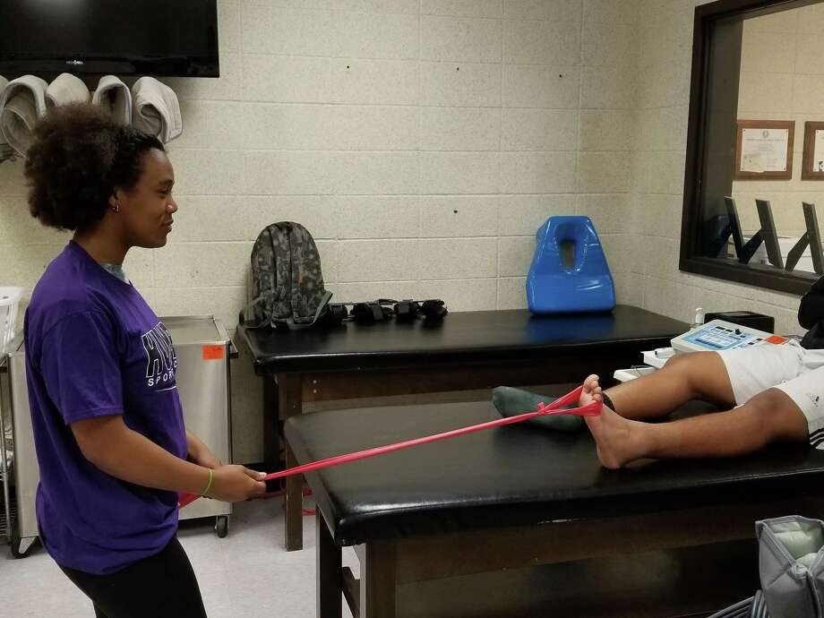 Hannah Williams, a student athletic trainer at Humble, helps out in the training room Photo: Humble Sports Medicine