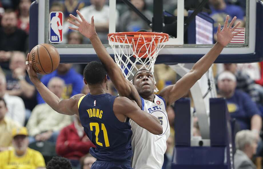 Indiana Pacers forward Thaddeus Young (21) shoots around Golden State Warriors forward Kevon Looney (5) during the first half of an NBA basketball game in Indianapolis, Thursday, April 5, 2018. (AP Photo/Michael Conroy) Photo: Michael Conroy / Associated Press